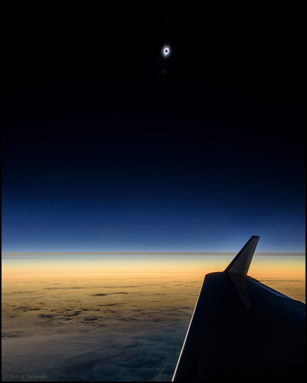 On a jet 45000 ft above the Pacific, the first view to August 2017 total solar eclipse is photographed before the moon shadow reaches the mainland US.